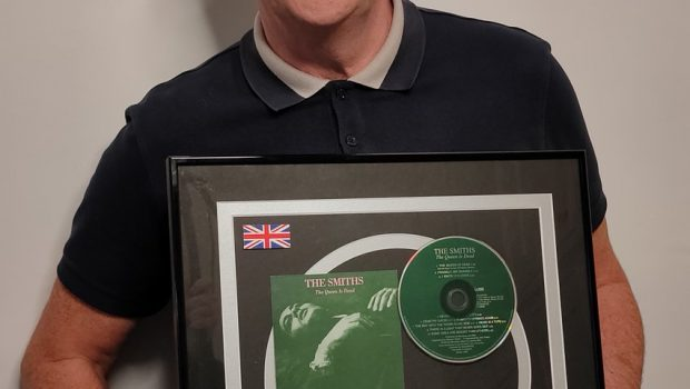 MIKE JOYCE ANNOUNCES RAFFLE OF PLATINUM DISC TO SUPPORT BACK ON TRACK